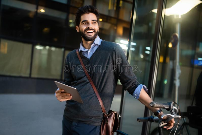 Portrait of young businessman holding tablet outdoor stock photo