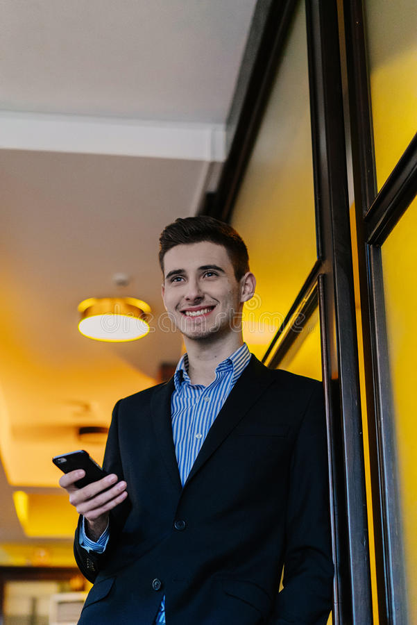 Portrait of a young businessman on phone stock images
