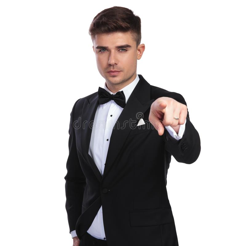 Portrait of young businessman pointing finger while standing royalty free stock photos