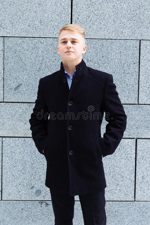 Portrait of young businessman walking in the city stock images