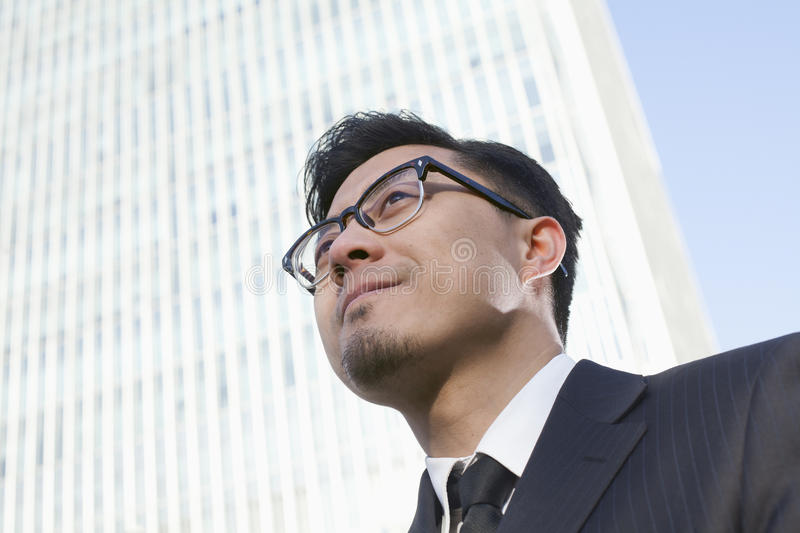 Portrait of young businessman by the world trade center in Beijing, China stock photo
