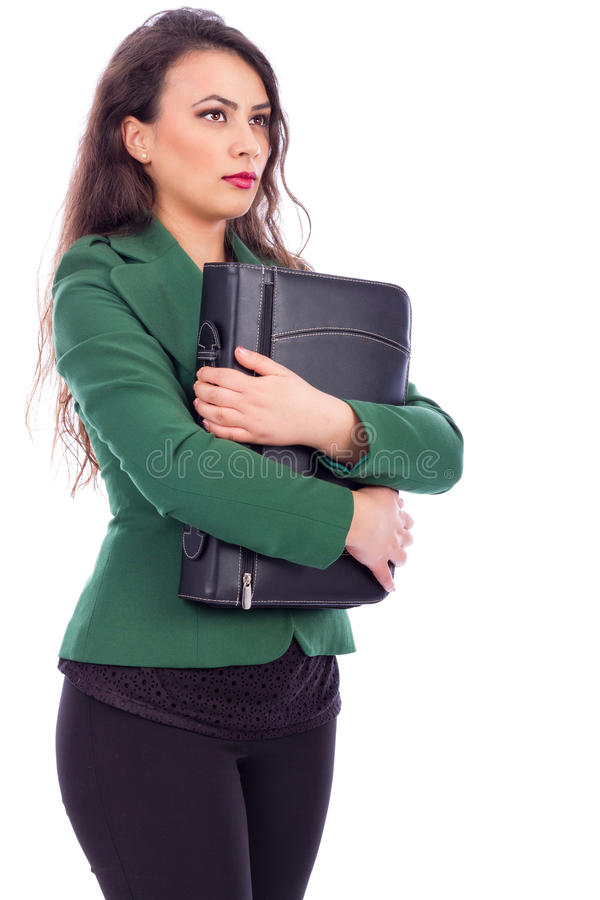 Portrait of a young businesswoman holding a briefcase stock photo