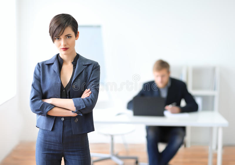 Portrait of a young businesswoman leader. In the office royalty free stock image