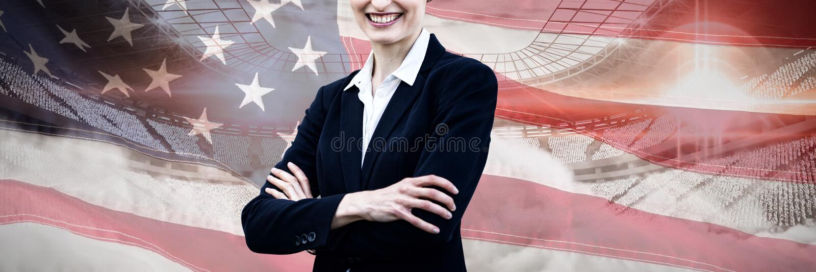 Composite image of portrait of young businesswoman standing with arms crossed royalty free stock image