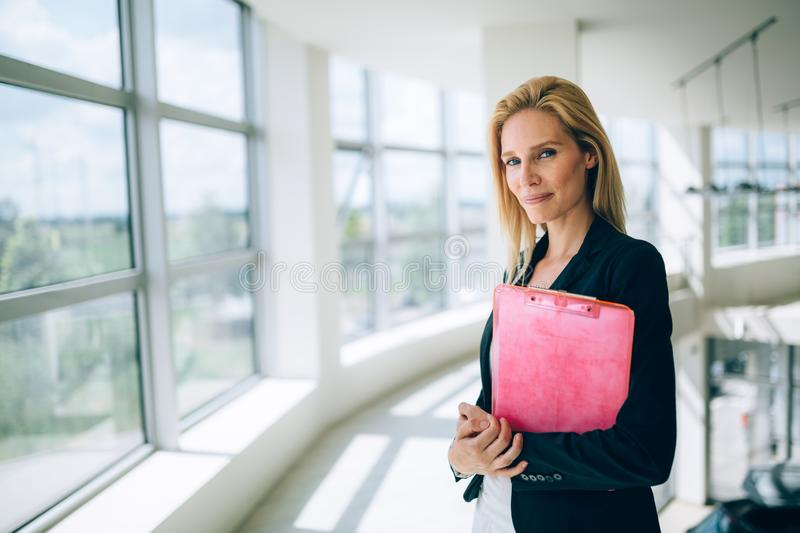 Portrait of young busineswoman standing in office lobby. Portrait of young beautiful busineswoman standing in office lobby stock image