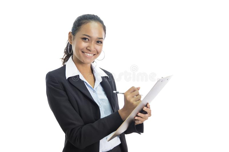 Young busineswoman writing report while standing and smiling. Portrait of young busineswoman writing report while standing and smiling isolated on white stock images
