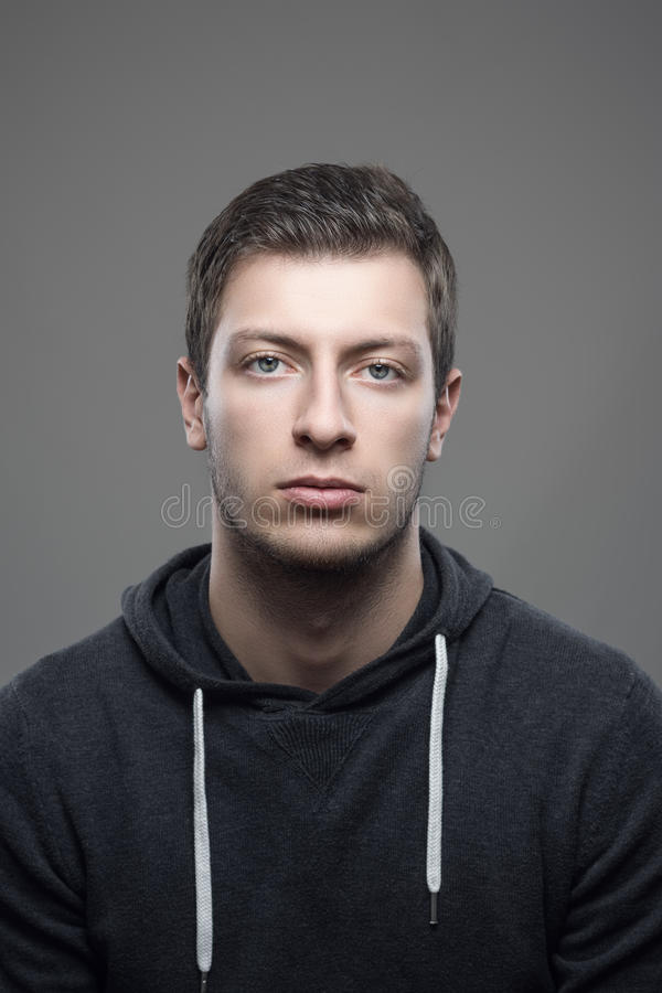 Portrait of young casual man looking at camera royalty free stock photos