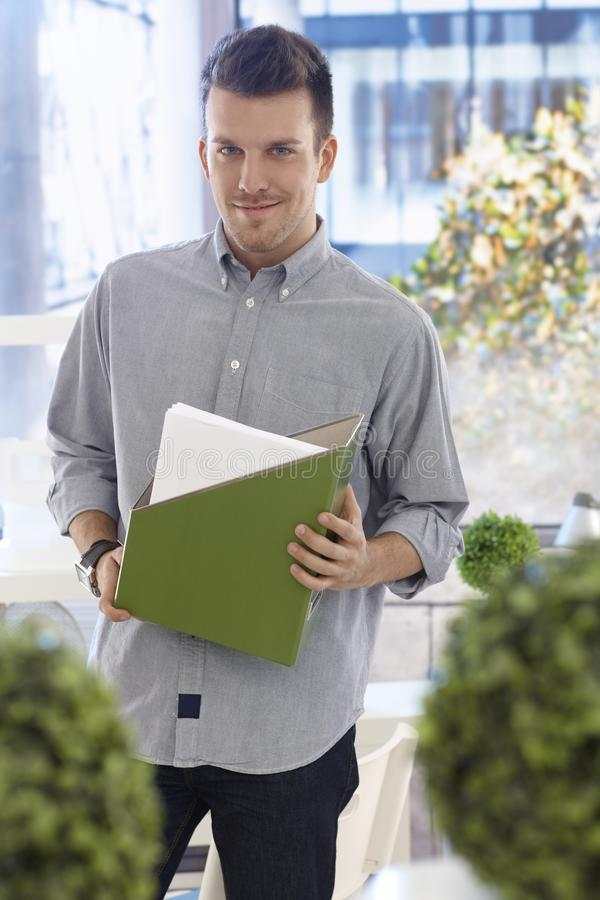 Portrait of young casual office worker smiling royalty free stock photo