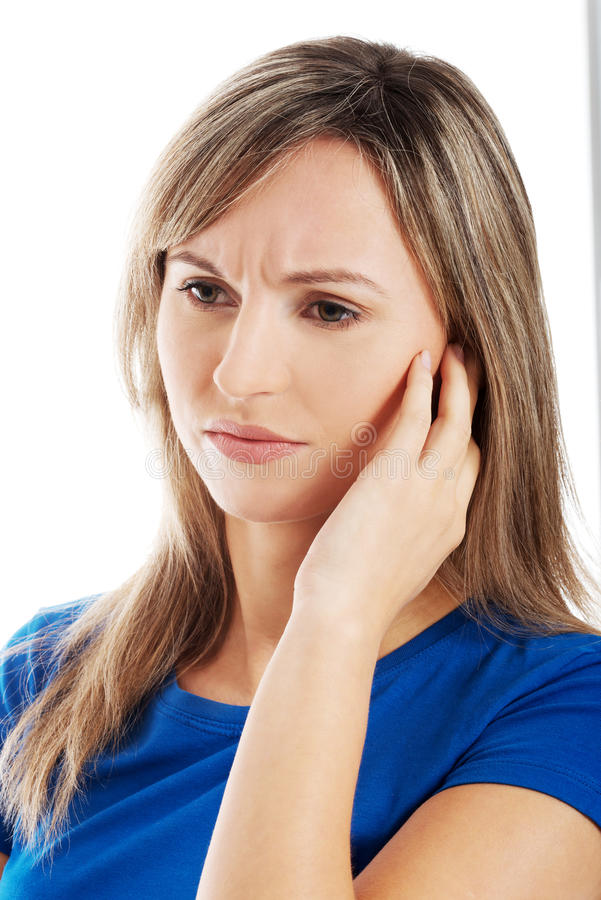 Portrait of young casual woman touching her face. stock photo