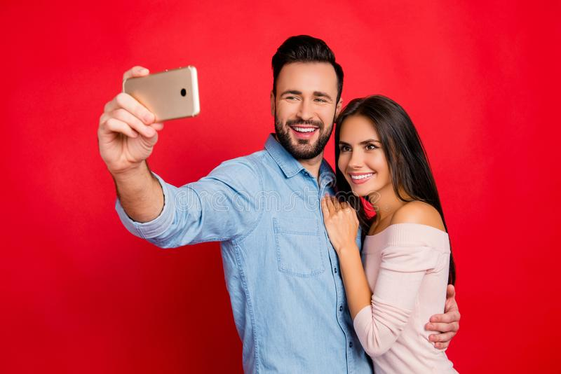 Portrait of young, caucasian, attractive, lovely, cute, smiling, positive, couple, man making selfie with his wonderful woman on stock photography