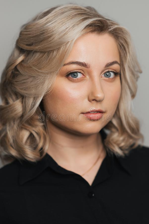 Portrait of young Caucasian blonde girl with Nude makeup stock image
