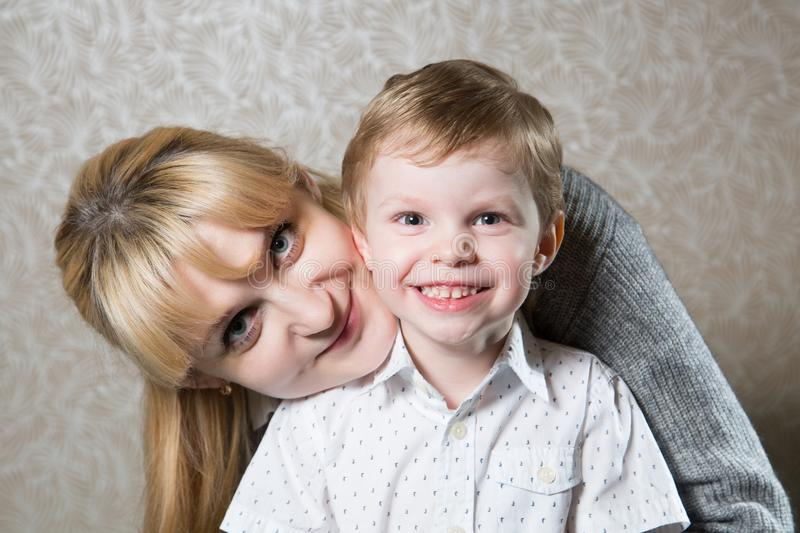 Portrait of young caucasian blonde woman with her son stock images