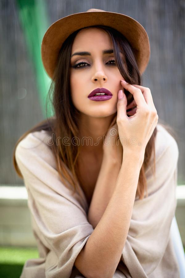 Young woman with hat. Portrait of young caucasian woman with hat looking at camera royalty free stock photos