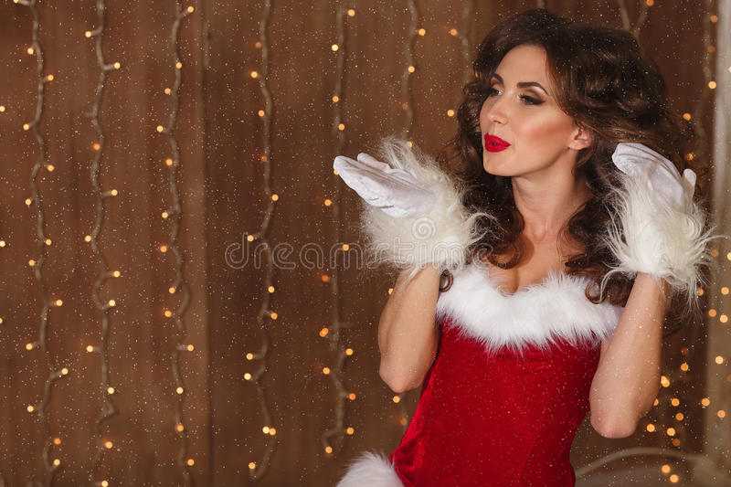 Portrait of a young charming girl dressed as Santa. Happy New Year! stock photos