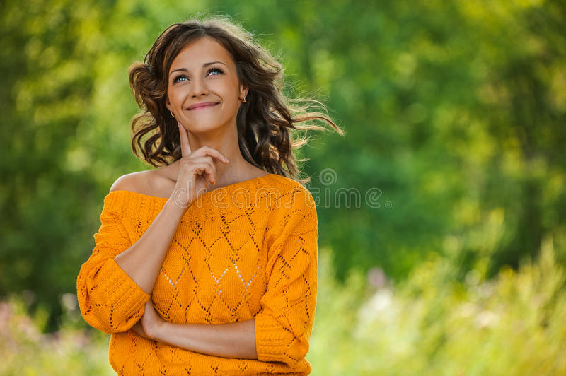 Portrait young charming long-haired curly woman stock photo