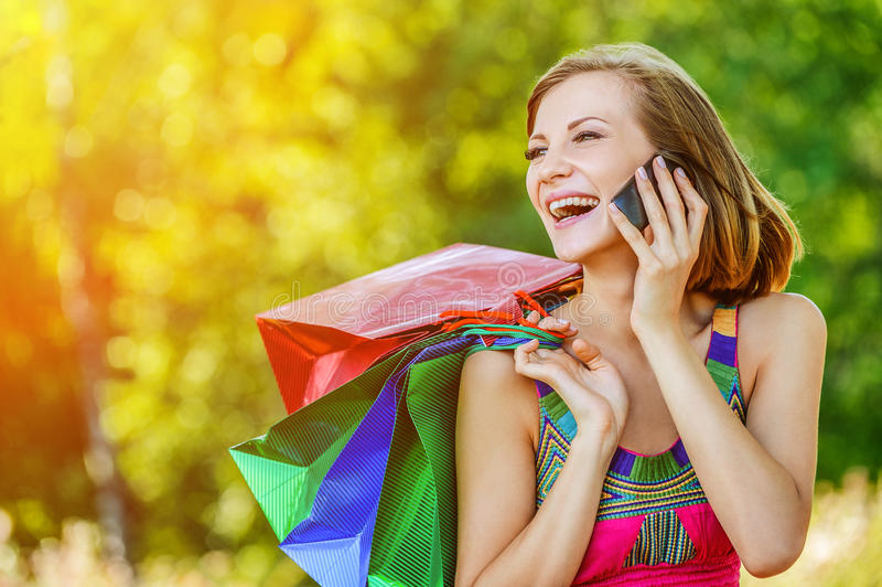 Portrait young charming short-haired woman shopping royalty free stock photos