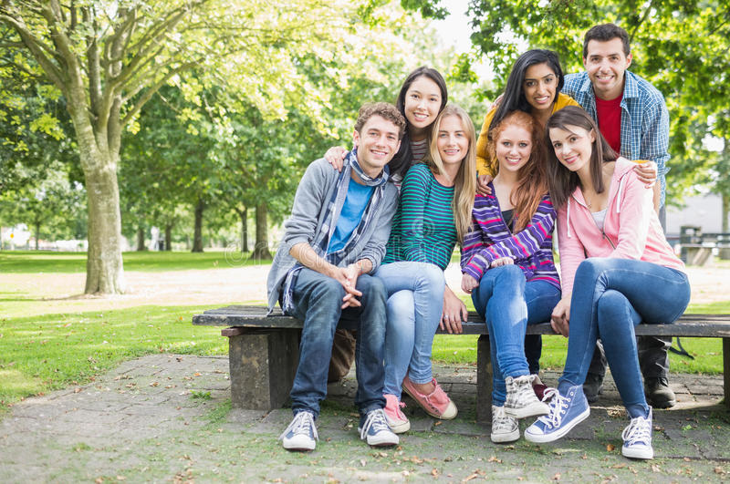 Portrait of young college students in park stock image