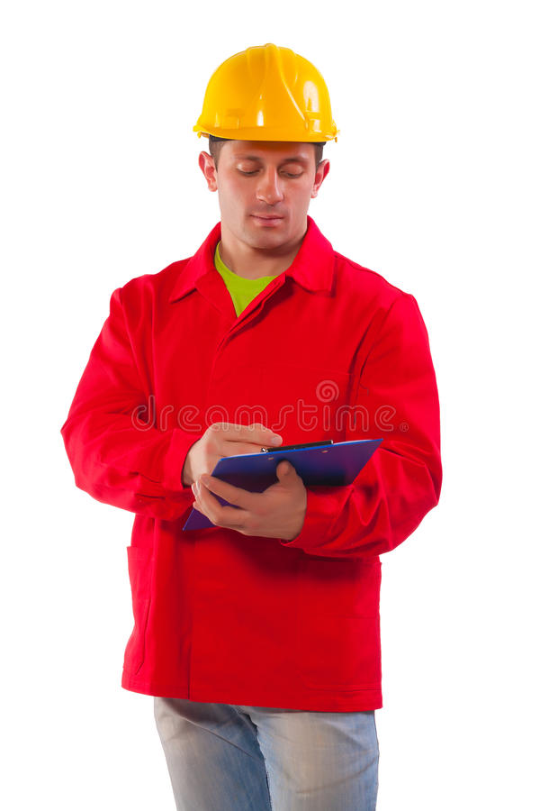 Portrait of young conctruction worker wearing red coat isolated stock image