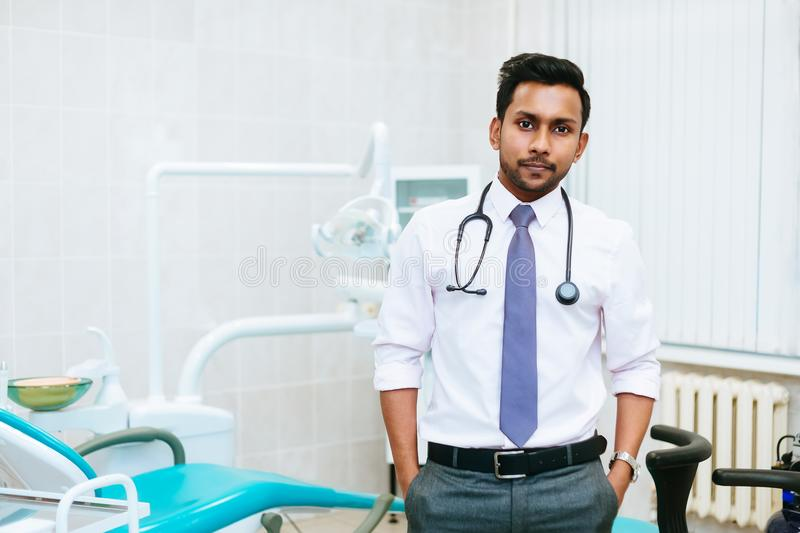 Portrait of a young confident asian male dentist in clinic. Dental clinic concept stock images