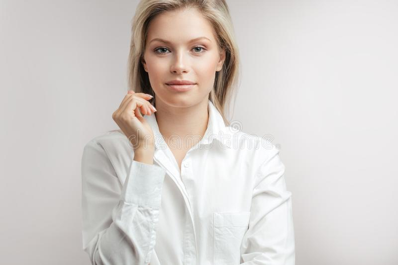 Portrait of young confident business woman isolated over white background stock photos