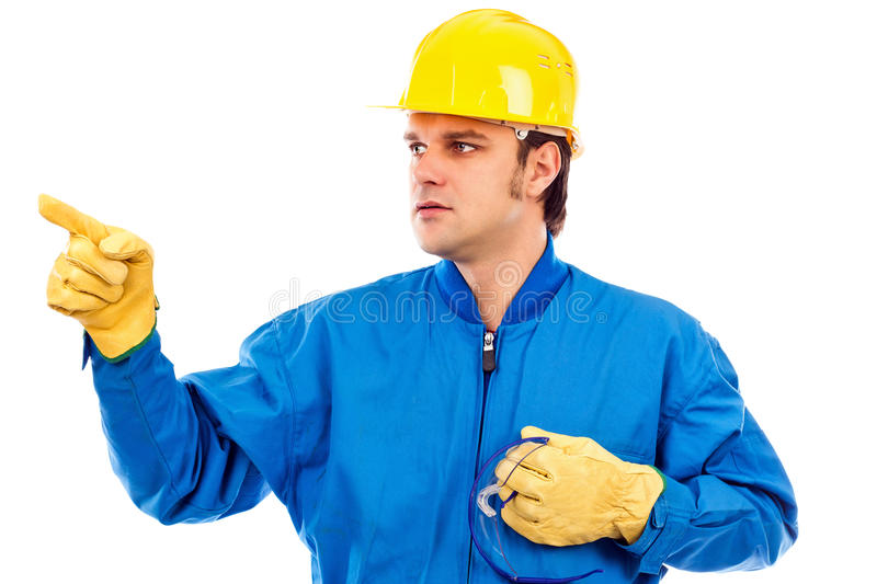 Portrait of a young construction worker pointing something stock photos