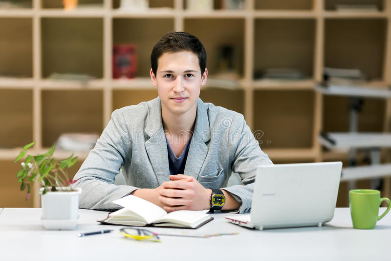Portrait of Young corporate Trainee at cozy working Place stock images