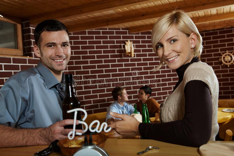 Download Portrait Of Young Couple In Bar Stock Photo - Image: 25641872