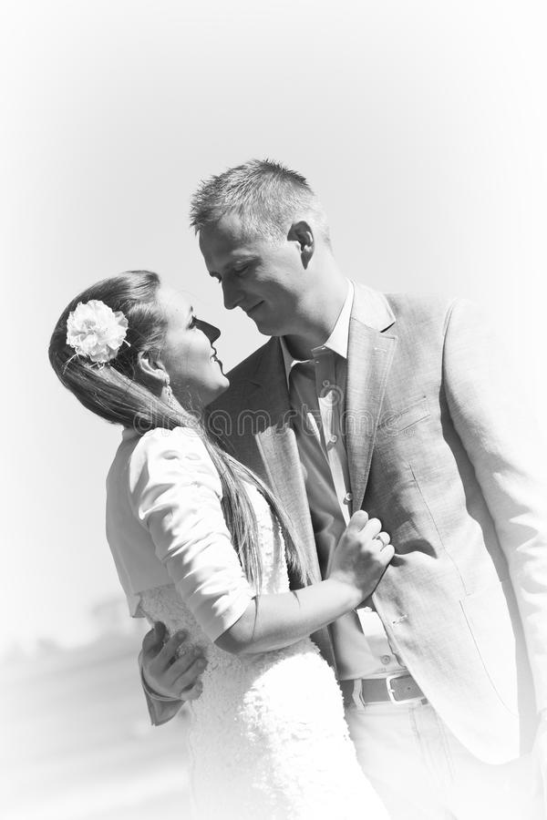 Portrait of young couple in black and white stock photography