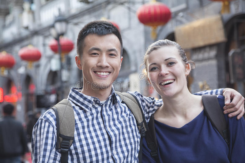 Portrait of young couple with Chinese Architecture in background. stock photography