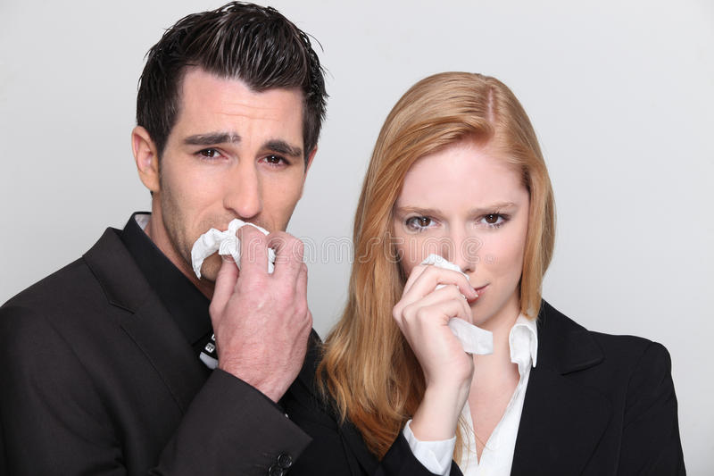 Portrait of a young couple crying stock images