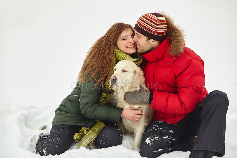 Couple with a dog on winter royalty free stock photo
