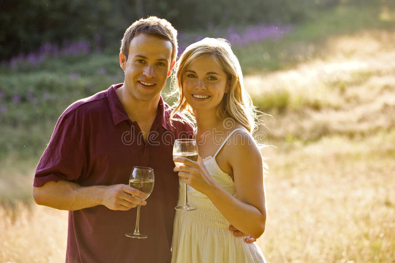 Portrait of a young couple drinking wine stock photo