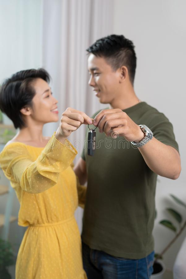 Portrait of young couple feeling happy about buying a new car royalty free stock photos