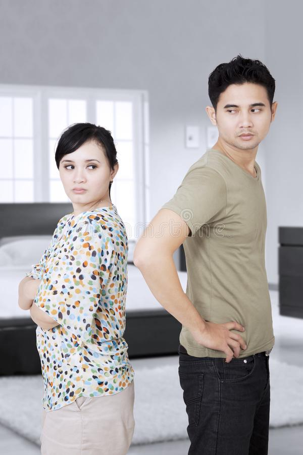 Young couple having a quarrel in the bedroom royalty free stock photography