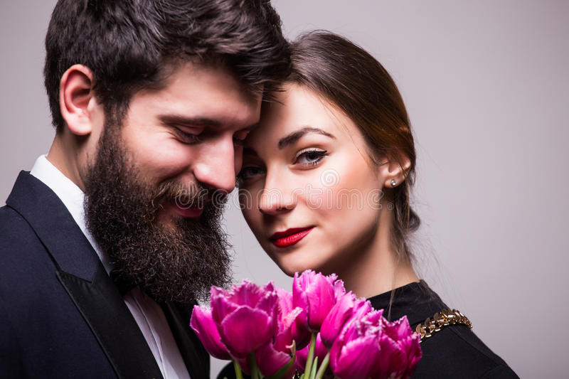 Portrait of young couple with lila tulips royalty free stock images