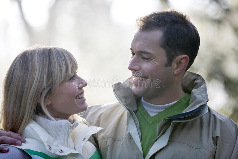 Portrait of a young couple looking at each other, smiling royalty free stock photo