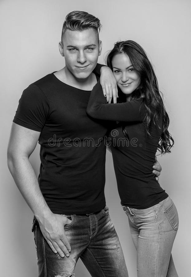Portrait of young couple in love posing at studio stock photography