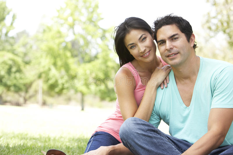 Portrait Of Young Couple In Park stock photography