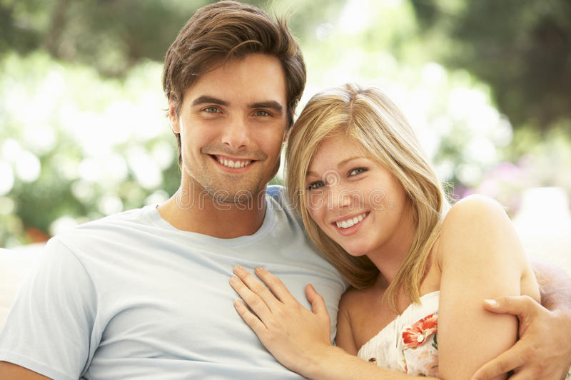 Portrait Of Young Couple Relaxing On Sofa royalty free stock photos