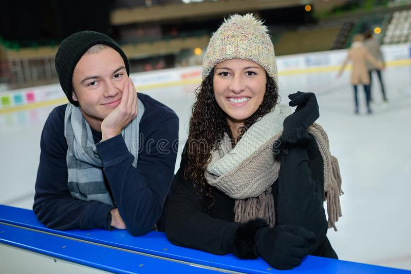 Portrait young couple at side ice rink royalty free stock photography