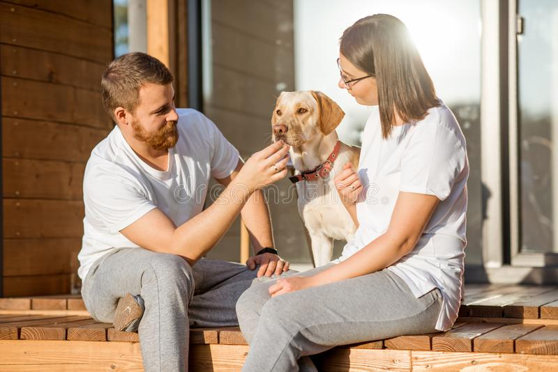 Couple with dog on the backyard stock photos