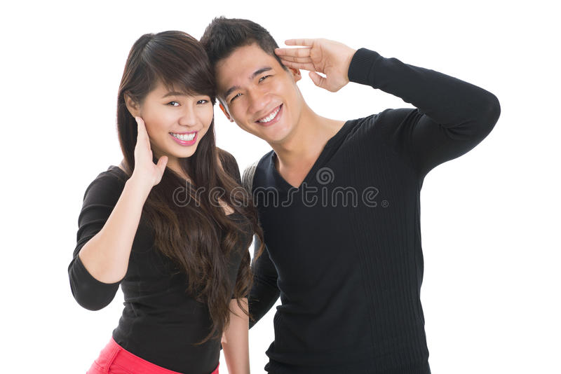 Salute!. Portrait of a young couple smiling and looking at camera stock photos