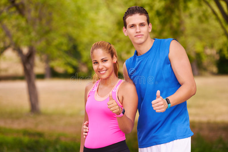 Portrait Young Couple With Thumb Up Doing Sports Training Fitness royalty free stock photos