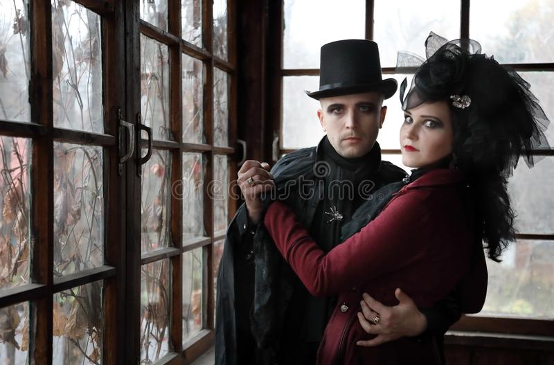 Portrait a young couple wearing vampire-style clothes stock photo