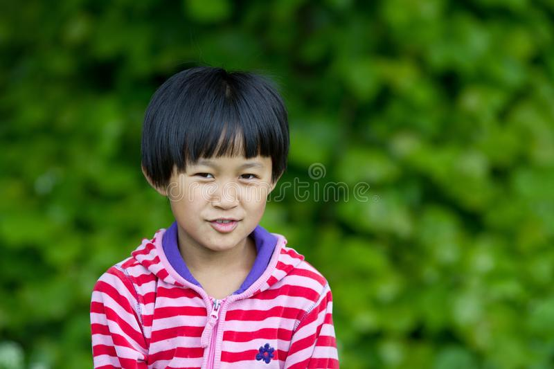 Portrait of a young cute girl looking at the camera royalty free stock photos