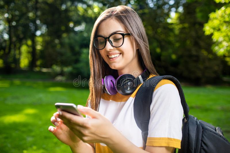 Cute Student Girl Checking Smartphone stock photography