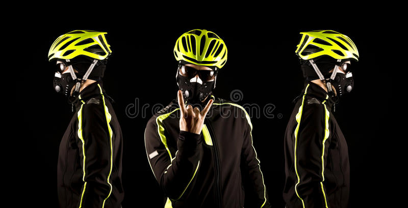 Portrait of young cyclist fully equipped for race in helmet and and mask. stock image