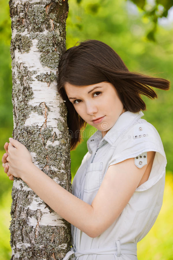 Portrait of young dark-haired woman stock photography