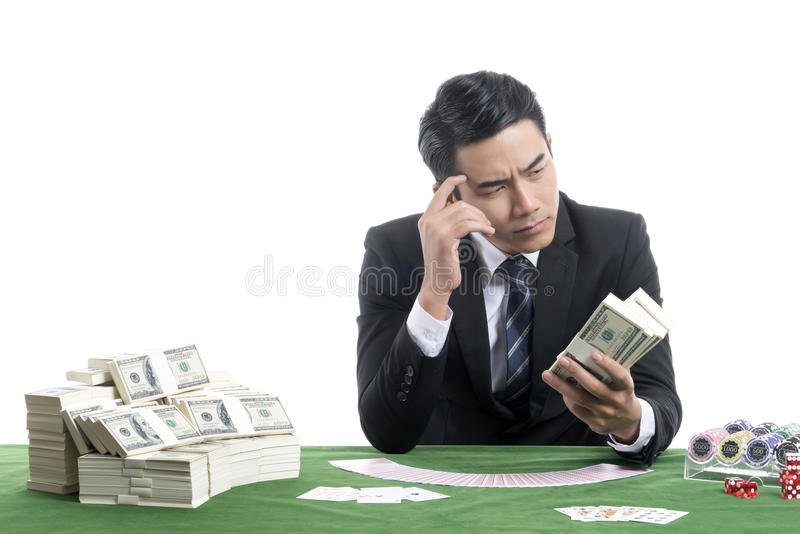 Portrait of young dealer man thinking about dollars in hand royalty free stock photography