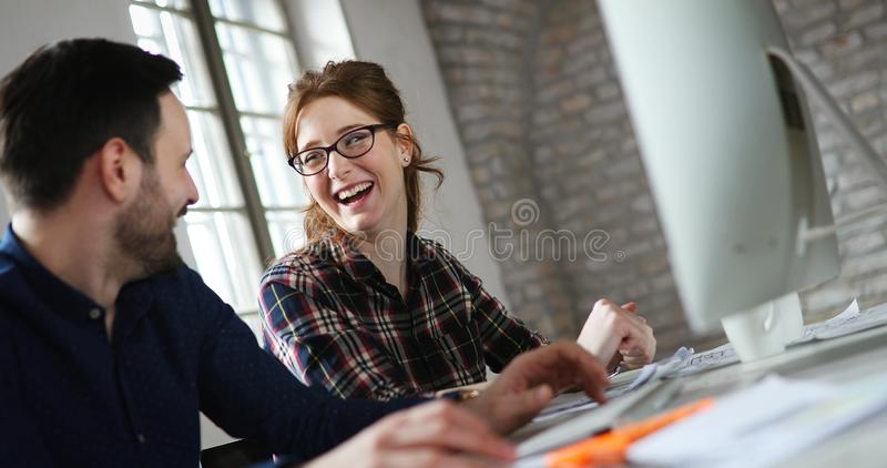 Portrait of young designers working on computer royalty free stock images